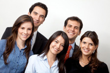 6336145-successful-business-people-at-the-office-smiling[1]
